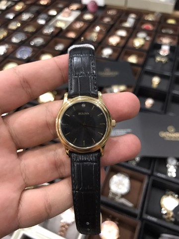 Bulova Women's Watch Gold Tone and Black Dial 97Y01