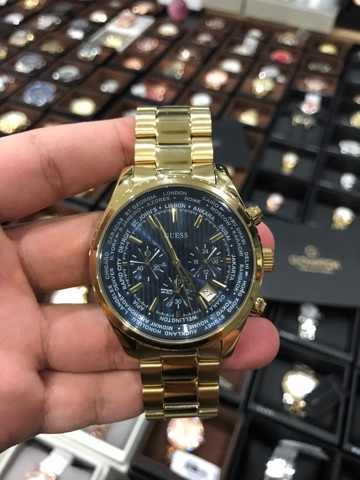 GUESS Men's U0602G1 Gold-Tone Chronograph Watch with Iconic Blue Dial & Date Function