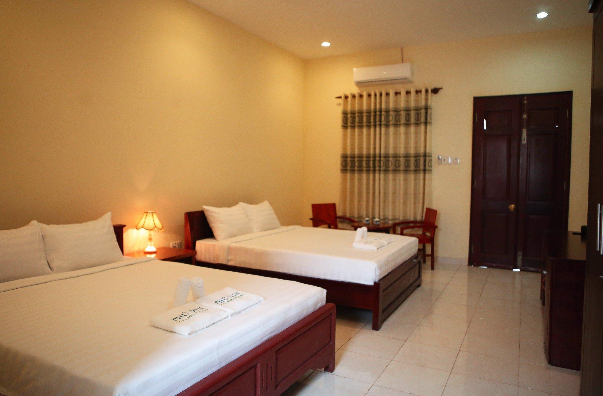 Quadruple room with garden view – Phu Son Village Resort