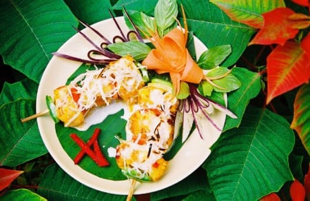 Grilled skewers of fish with coconut and a sate sauce
