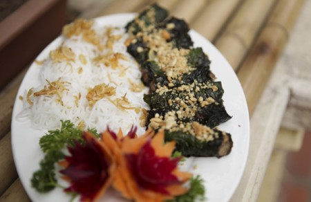 Grilled beef in betel leaves served with rice noodles