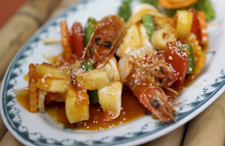 Grilled seafood skewers with a sate sauce