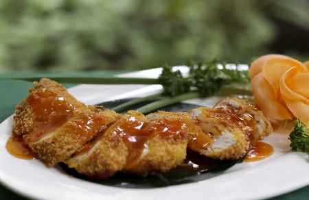 Fried fish rolled with minced shrimp with ginger , chili sauce