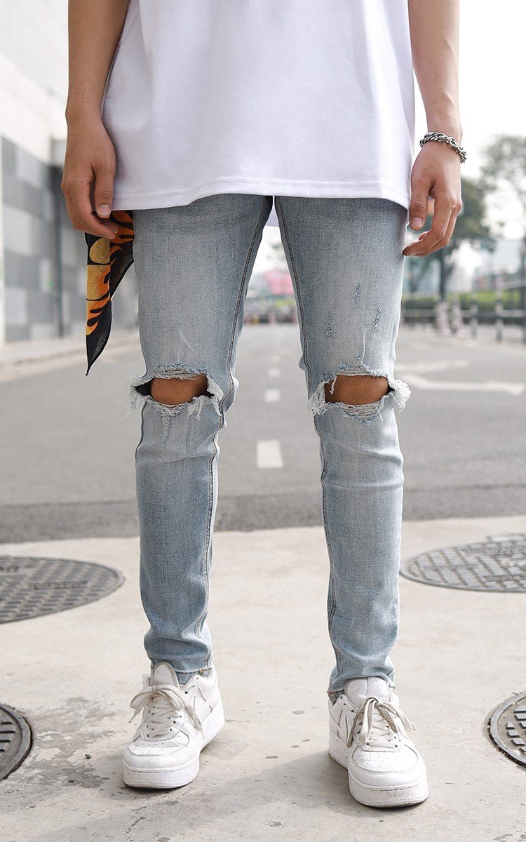 Skinny Jeans With Knee Rips In Mid Wash Blue
