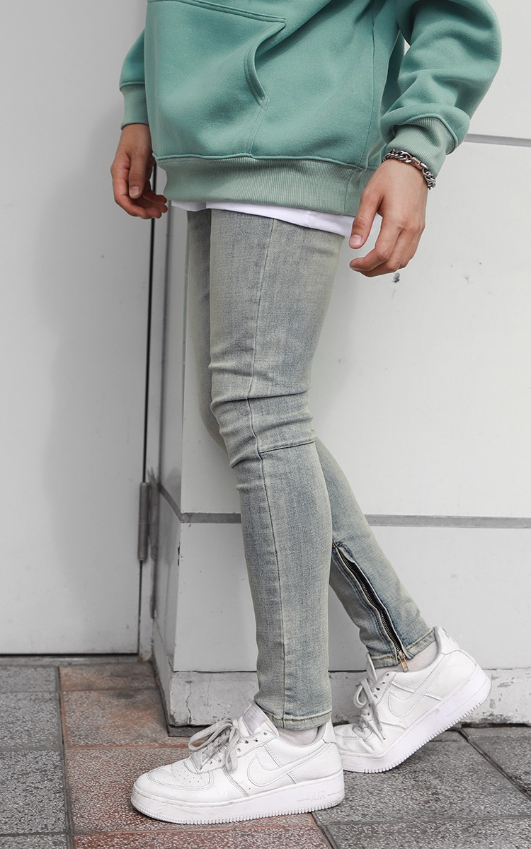 Skinny Jeans With Zipper In Mid Wash Blue