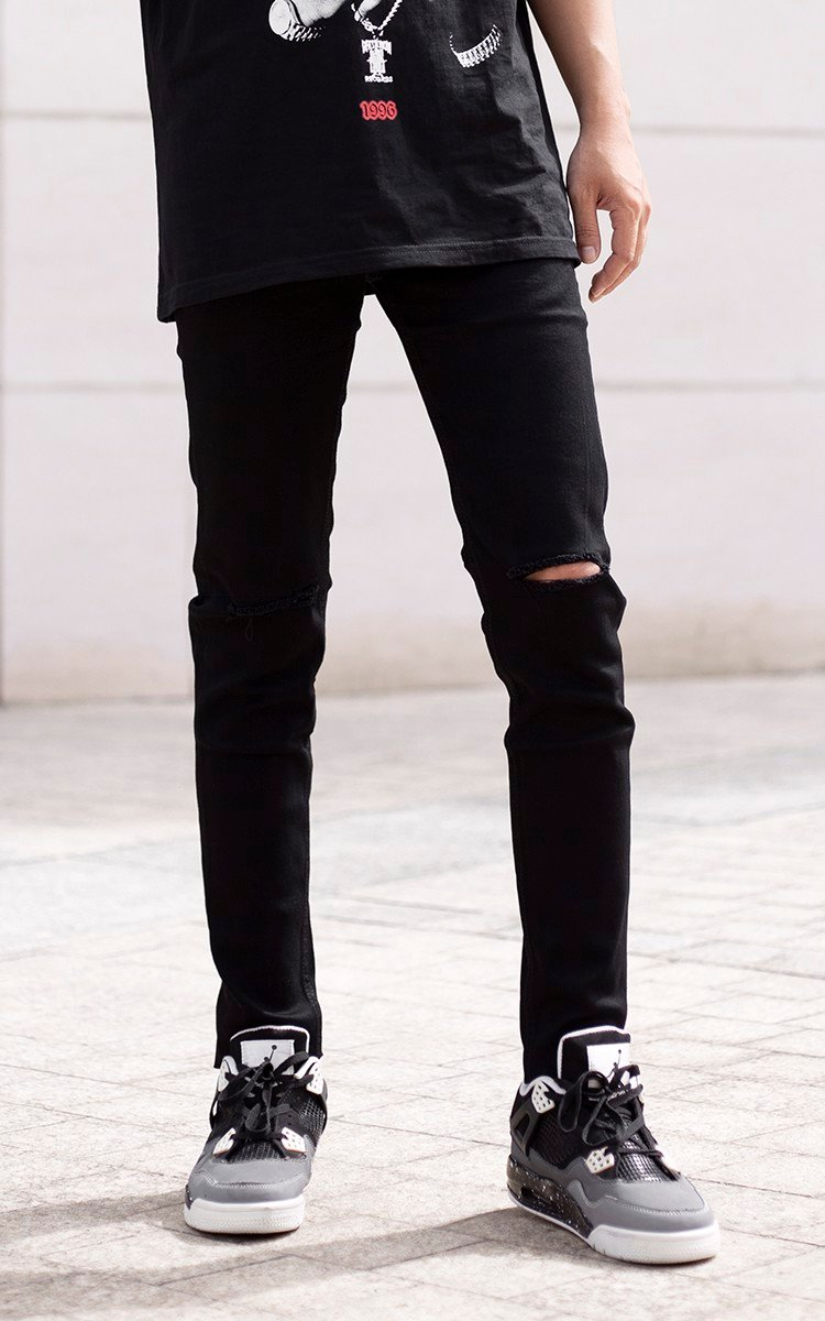 Skinny Jeans With Knee Rips In Black