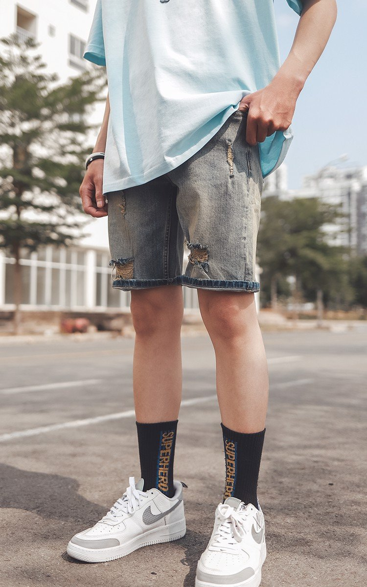 Distressed Denim Shorts In Vintage Dirty Wash Blue