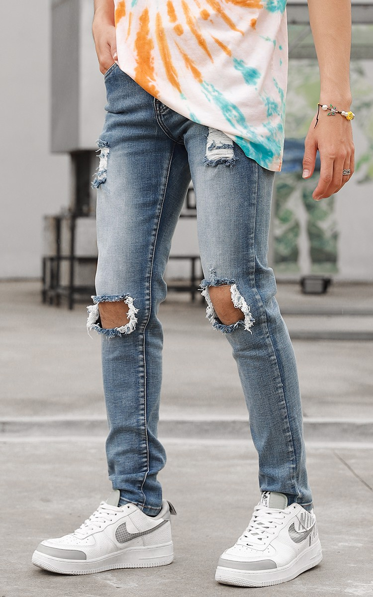 Distressed Skinny Jeans In Mid Wash