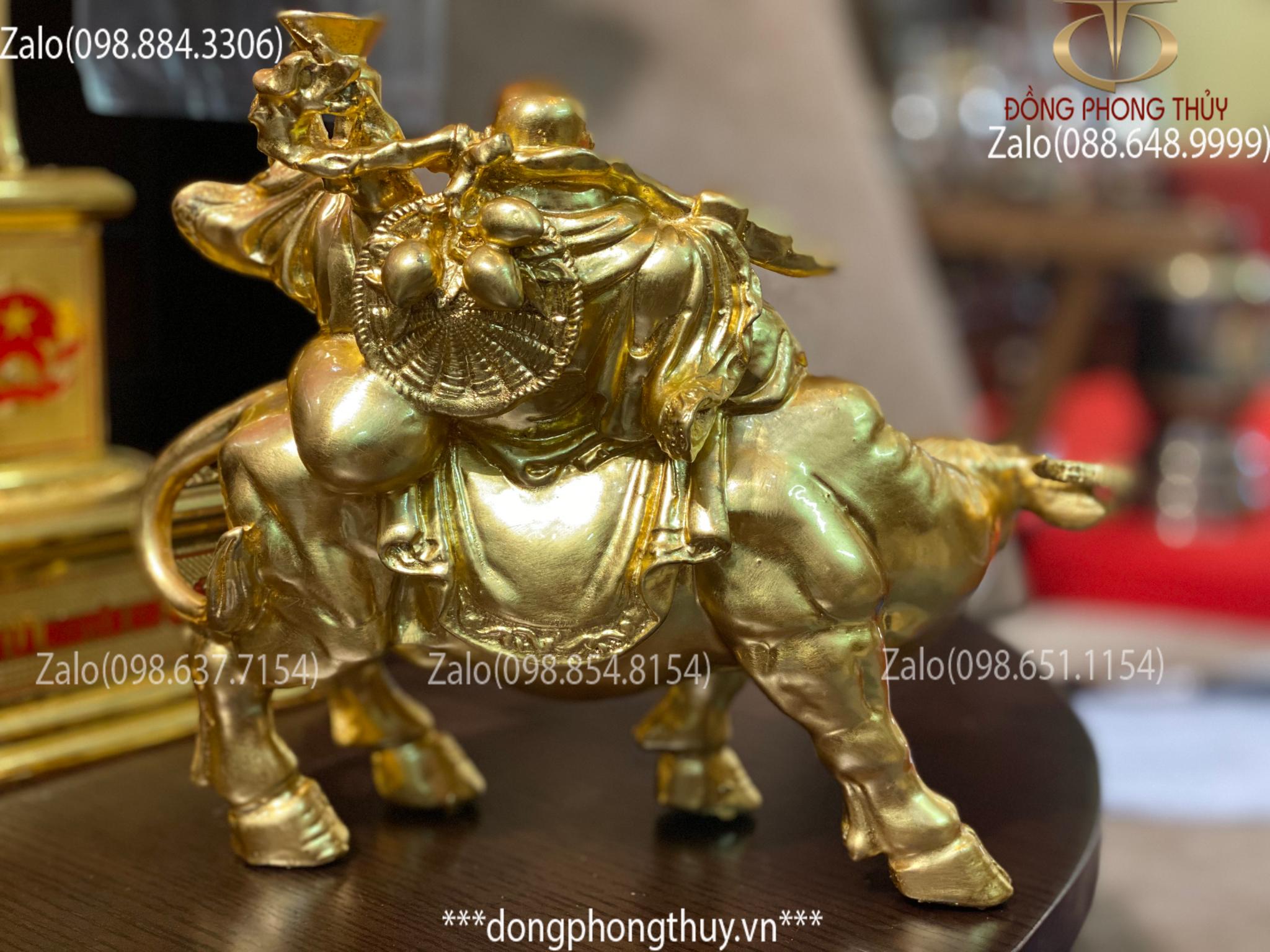 Tượng di lặc cưỡi trâu bằng đồng thếp vàng 24k