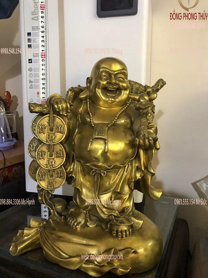 Tượng di lặc đứng bị gánh bao tiền bằng đồng cao 40 ngang 33cm nặng 7,5kg
