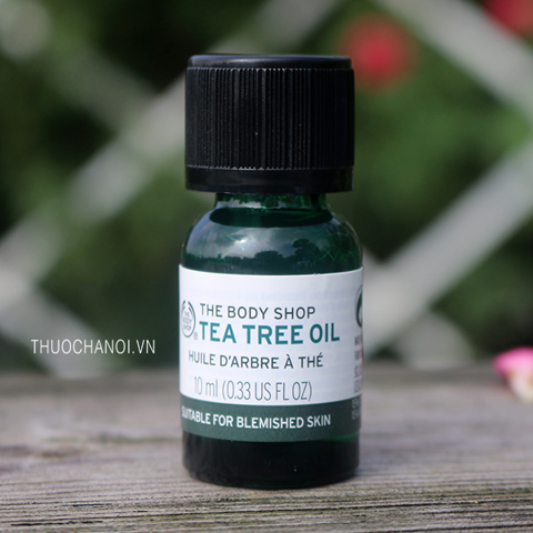Tinh dầu trà trị mụn The Body Shop Tea Tree Oil