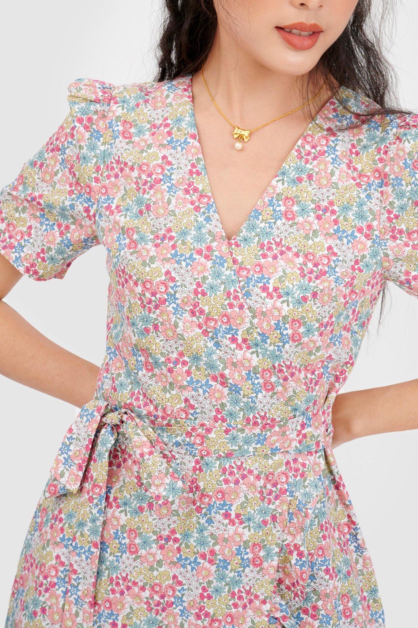 Đầm đắp chéo mini cột nơ hoạ tiết hoa