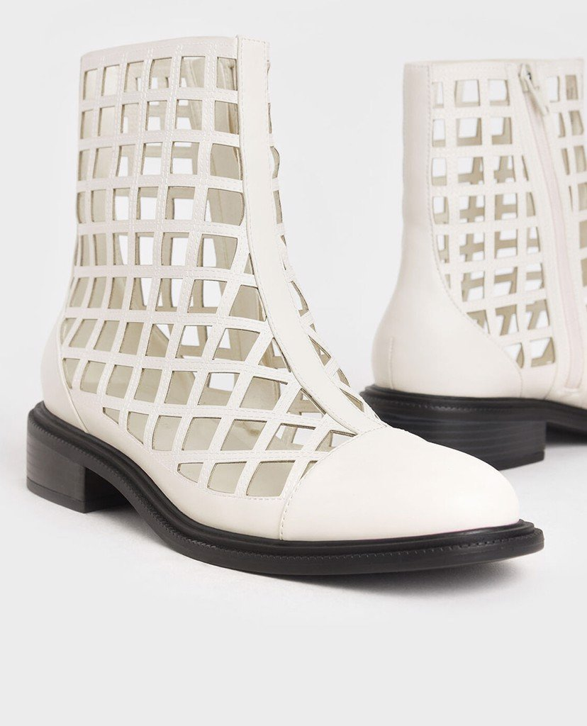 CHARLES & KEITH - Giày boots nữ mũi nhọn Caged