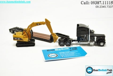 Mô hình Peterbilt Model 389 With Trailking Lowboy Trailer And Cat 1:87 Norscot