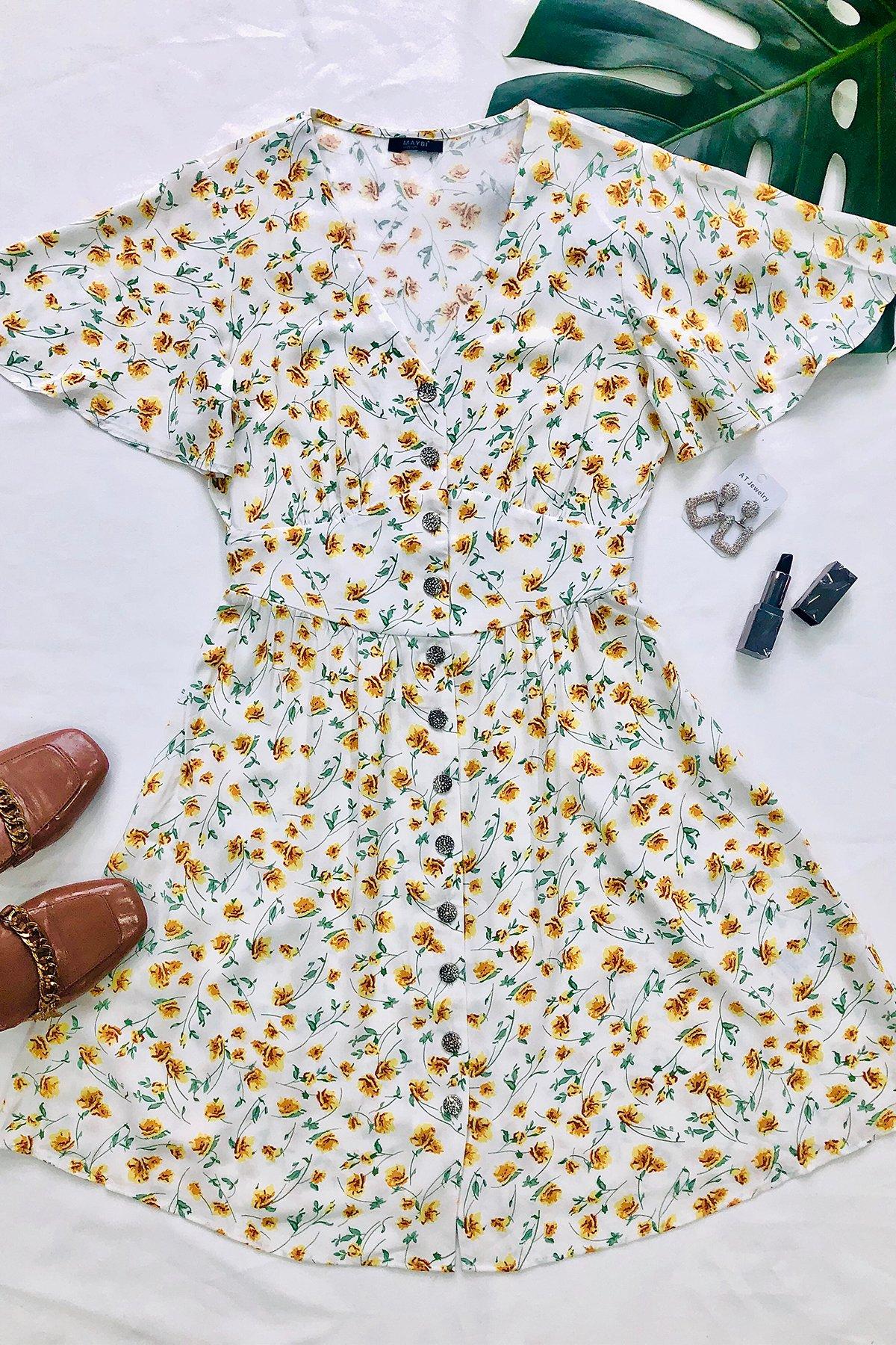 Đầm trắng hoa vàng cổ V cài nút tay cánh tiên Yellow dotties dress