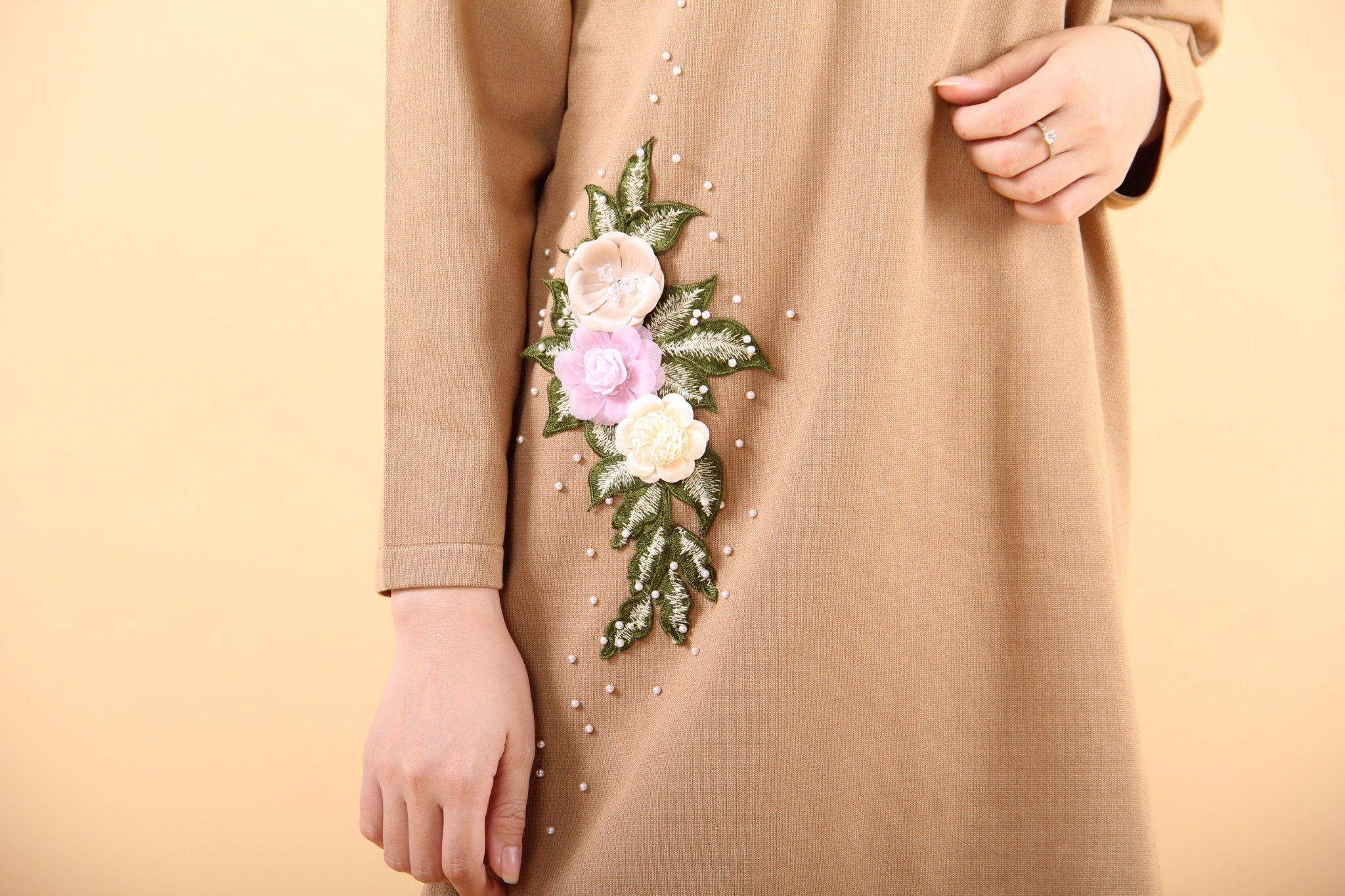 Fabric flowers on brown shift dress