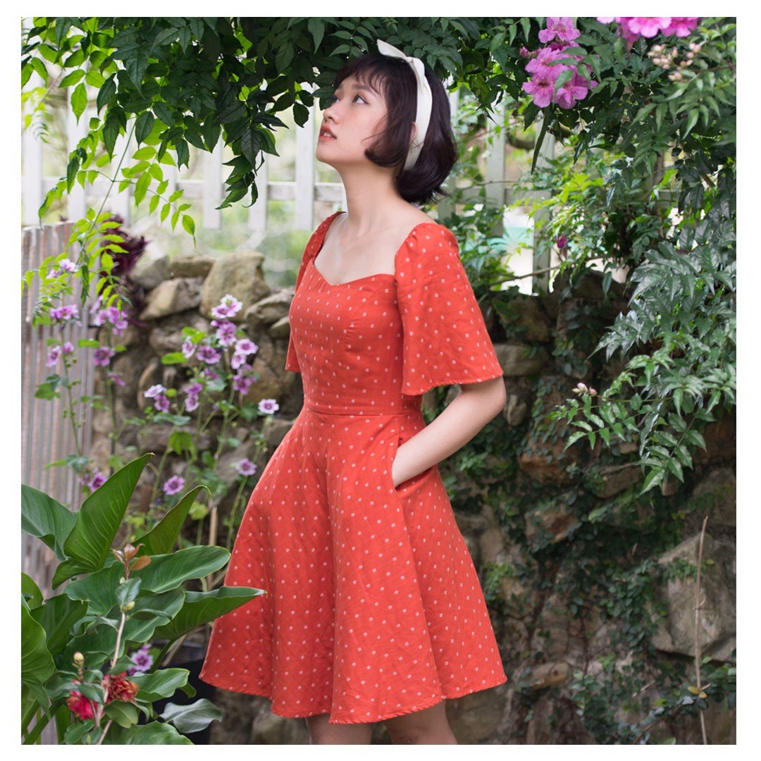 bell-sleeve dress in orange with hash