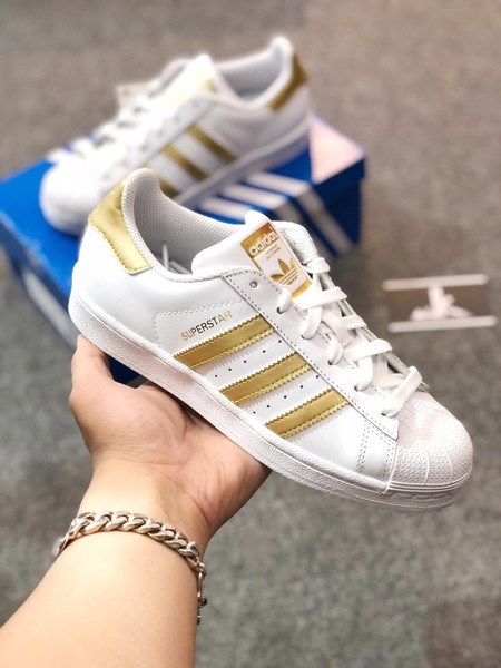 B39402 - Superstar Sọc Gold
